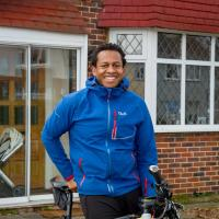 Robert, an e-bike rider in London, standing with his e-bike in front of his home