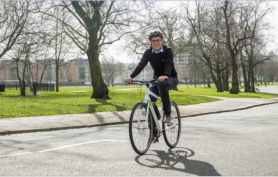 Will Norman, London's Walking and Cycling Commissioner riding an ebike at the press launch